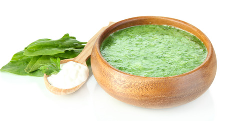 Tasty spinach soup, isolated on white photo