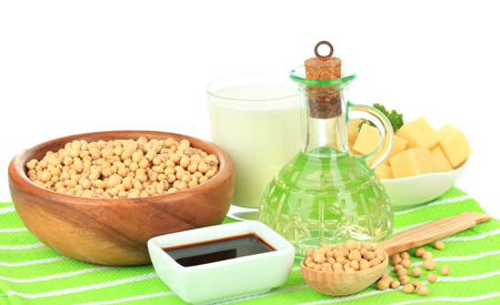 Soy products on table on white background photo