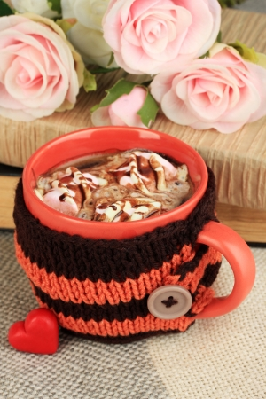 Cup with knitted thing on it close up photo