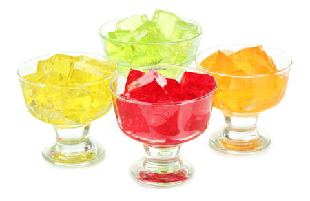 Tasty jelly cubes in bowls isolated on white Stock Photo