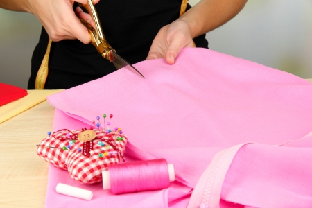 Cutting fabric with tailors scissors  photo