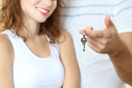 Young couple with keys to your new home close-up Stock Photo