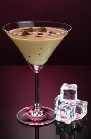 baileys: Baileys liqueur in glass on pink background Stock Photo