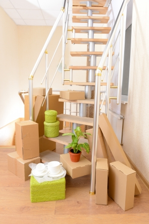 Stack of cartons near stairs: moving house concept  photo