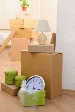 packaging move: Empty room with stack of cartons: moving house concept