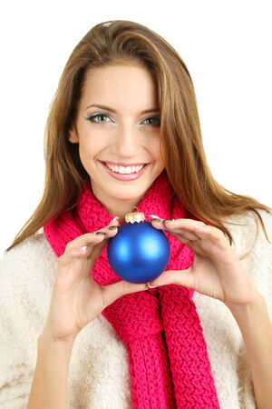 Beautiful smiling girl with Christmas ball isolated on white photo