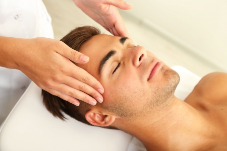 facial spa: Man having head massage close up