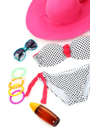 Swimsuit and beach items isolated on white photo