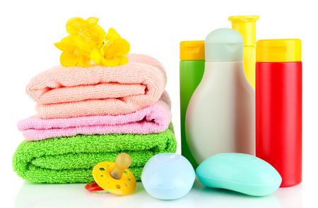 Baby cosmetics, towels and soap, isolated on white photo