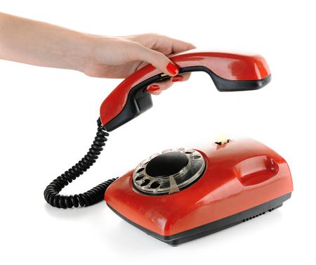 Red retro telephone, isolated on white photo