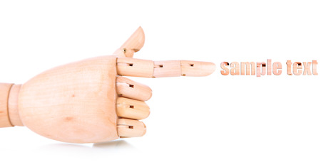 Wooden hand isolated on white photo