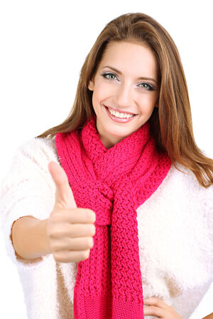 Beautiful smiling girl in warm knit scarf isolated on white photo