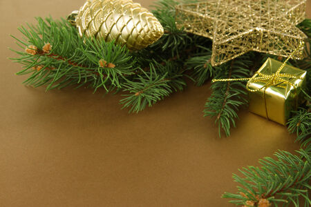 Beautiful Christmas decorations on fir tree on brown background photo