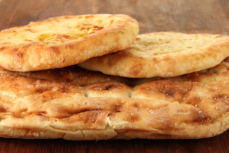 Pita breads on wooden background photo