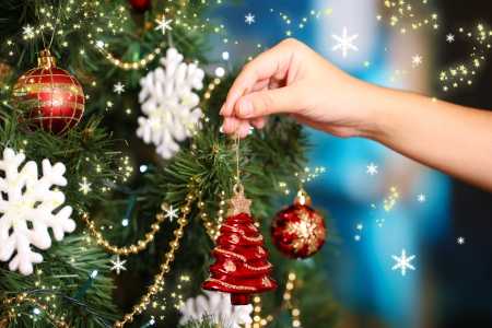 decorating christmas tree: Decorating Christmas tree on bright background