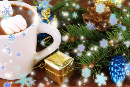 Cup of hot cacao with Christmas decorations on wooden background photo