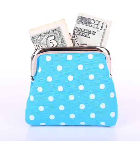 Blue purse with money isolated on white photo