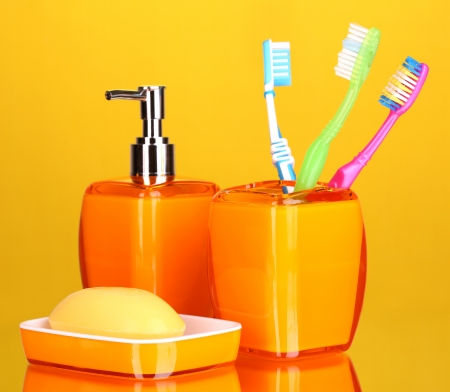 Bathroom set on yellow background photo