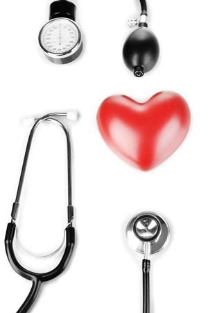 Tonometer, stethoscope and heart isolated on white Stock Photo - 24104651
