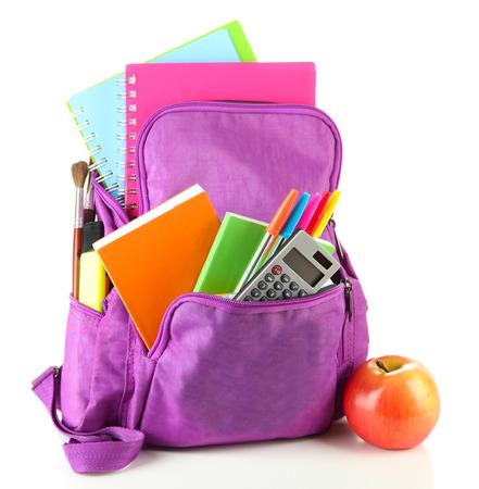 school backpack: Mochila púrpura con útiles escolares aislados en blanco Foto de archivo