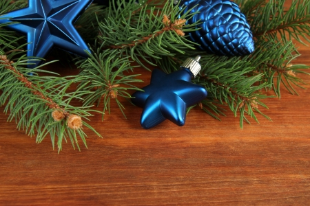 Beautiful Christmas decorations on fir tree on wooden background photo