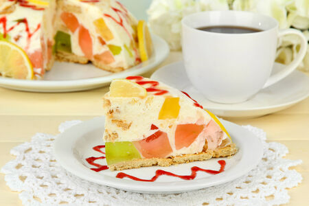 Delicious jelly cake on table close-up photo