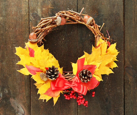 Beautiful Thanksgiving wreath, on wooden background photo