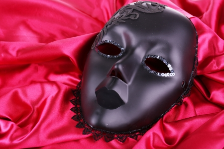 Mask on bright pink fabric background photo