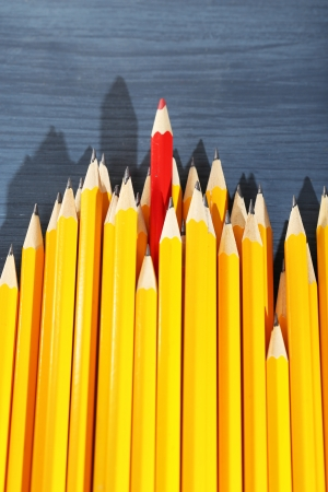 usual: Celebratory pencil among usual pencils, on color background