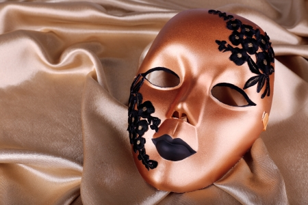 canvass: Mask on golden fabric background