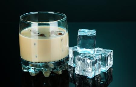baileys: Baileys liqueur in glass on blue background