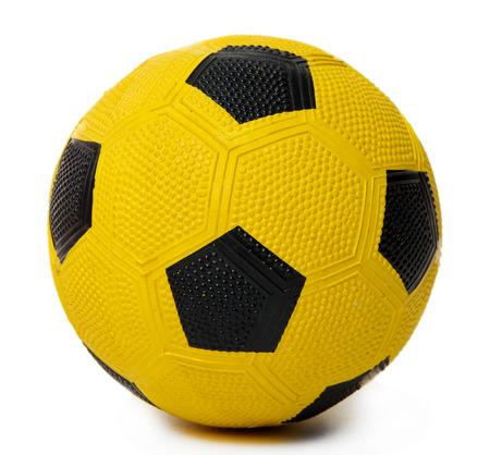 futbol infantil: Bal�n de f�tbol amarillo de los ni�os, aislados en blanco Foto de archivo