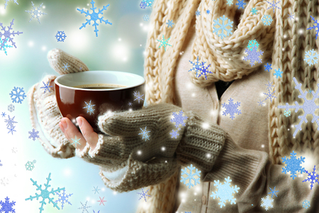 cold meal: Female hands with hot drink, on light background Stock Photo