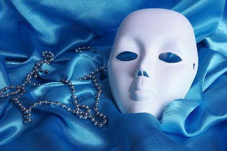 Mask on blue fabric background photo