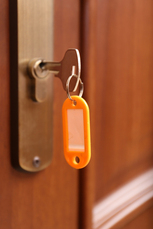 Locking up or unlocking door with key  photo