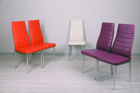Modern  color chairs on wall background photo