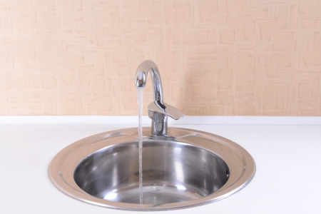 Water tap and sink in  modern kitchen photo