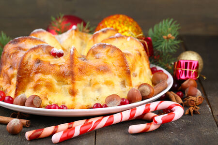 christmas cake: Tasty homemade Christmas cake, on grey wooden background Stock Photo