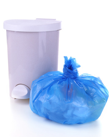 Garbage bin and  plastic trash bag, isolated on white Stock Photo