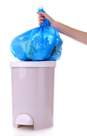 Hand holding trash bag, isolated on white photo