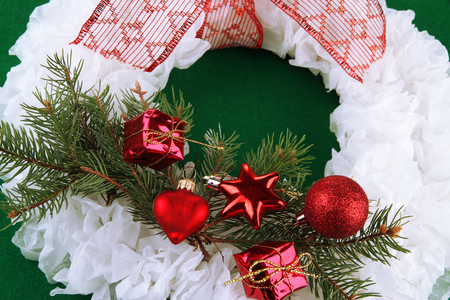 Christmas wreath on fabric background photo