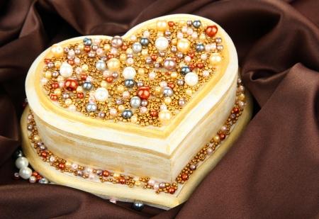 Beautiful hand made casket, on silk background photo