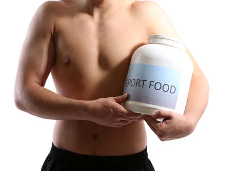 Handsome young muscular sportsman with protein food, isolated on white photo