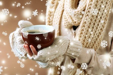Female hands with hot drink, on color background Stock Photo