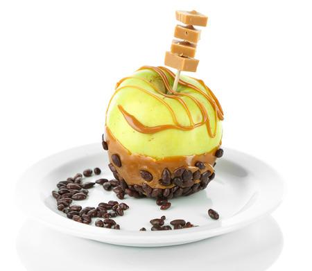 taffy apple: Homemade taffy apple, isolated on white