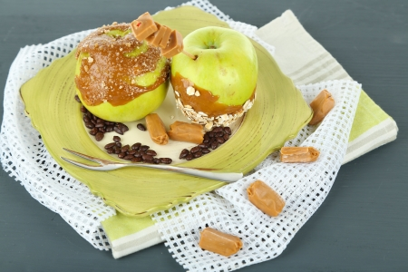 taffy: Homemade taffy apples, on napkin, on wooden background Stock Photo