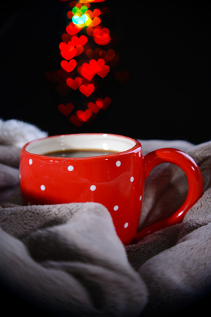Cup of coffee with plaid on dark background photo
