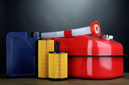Diesel and oil canisters on grey background photo