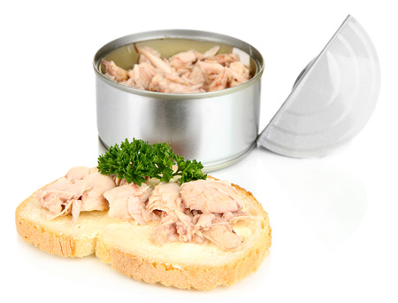 Open tin can and tasty sandwich with tuna, isolated on white photo