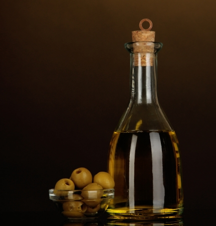 Original glass bottle with oil on dark color background photo
